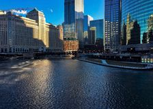 Morning light reflects over winter ice on Chicago River in February. Morning light reflects over winter ice on Chicago River in Februar.  Riverwalk and Wacker Royalty Free Stock Photo
