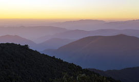 Morning Light Rises Across Mountaintops. Soft sunrise light rises across the hilltops in Yunnan Province, China Royalty Free Stock Photography