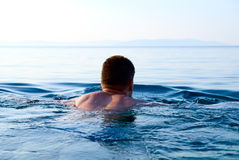 Morning light and swimming man Stock Image