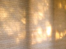 Morning light through window shades. Soft morning sunlight, filters through these honeycomb shades, showing soft morning light at dawn Royalty Free Stock Photography