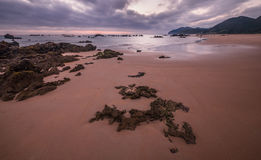 Morning Low tide. Sunrise sand beach near the Noja town, Cantabr Stock Photo