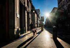 Morning in Madrid. Streets of the old city of Madrid. Early morning. A look against the sun stock photography