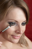 Morning make up. Woman is doing morning make up Royalty Free Stock Photo