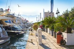Morning marina. Sea pier and promenade, seafront in old touristic town. Yachts parking in harbor at morning in Budva, Montenegro royalty free stock photography