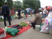 Morning market. Exercise every morning the old man, went to the market to buy cheaper food Stock Photos