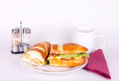 Morning meal. Breakfast on plate with napkin and cup of tea Stock Photo
