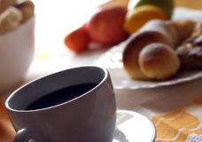Morning meal. Coffee,croissant and fruit Stock Photography