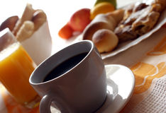Morning meal. Coffee,croissant ,orange juice,bread and fruit Stock Photography