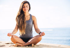 Morning Meditation. Morning Yoga Meditation by the Beach royalty free stock image