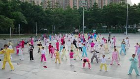 Shenzhen, China: men and women learn tai chi kung fu stock footage