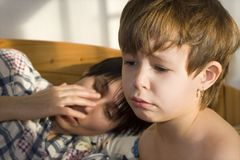 Morning misery. Of child in light Royalty Free Stock Photos