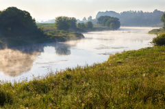 The morning mist. Утренний туман. Morning fog creeps over the river Royalty Free Stock Photography