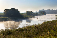 The morning mist. Утренний туман. Morning fog creeps over the river Stock Photography