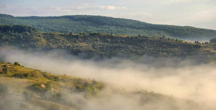 Morning mist. Over the hills Stock Photo
