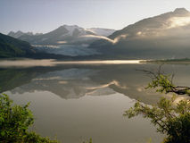 Morning Mist. View from campsite aside Mendenhall Lake in Juneau, Alaska, U.S.A. The face of Mendenhall Lake is behind the lake Royalty Free Stock Images