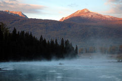 Morning mist. Morning,sun over the peak,a layer of fog on the river Royalty Free Stock Photography
