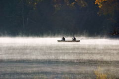 Morning Mist. Canoeing in early morning mist royalty free stock images