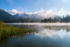 Morning mist above Strbske pleso mountain lake Royalty Free Stock Image