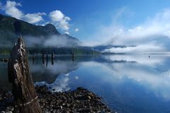 Morning mist on Alouette Lake. View from the camping spot on Alouette Lake - Vancouver-BC. June 2013 Royalty Free Stock Image