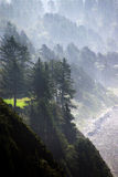 Morning mist on coastal hills Stock Image