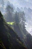 Morning mist on coastal hills Stock Photo