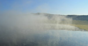 Morning Mist Hanging Over Lake. Altai, Siberia stock footage