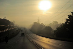 Morning. Mist at the morning. Long line of sight road Stock Images