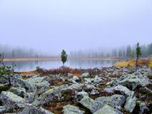 Morning mist on a mountain lake. Royalty Free Stock Photo