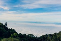 Morning mist in the mountains, bright blue sky, clouds in the fo. Reground Royalty Free Stock Photos