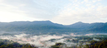 Morning mist and moutain landscape Stock Photos