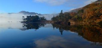 Morning mist at Muckross lake Stock Image