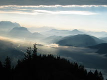 Morning Mist over the Alps. Misty mountains... Dreamy Sunrise over the Austrian Alps. You see the Inn Valley with Inn River of Tyrol Province. Picture taken from Royalty Free Stock Image