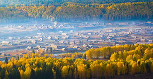 Morning mist over Hemu Village, Xinjiang China Royalty Free Stock Photo