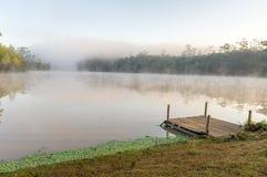 Morning mist over lake Stock Photos
