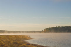 Morning mist over lake Stock Photos