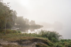 Morning mist over the lake with reflection in the water. Fog on a river Stock Photos
