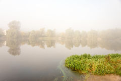 Morning mist over the lake with reflection in the water. Fog on a river Royalty Free Stock Photos
