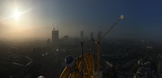 Morning mist over London from 80m up a tower crane Royalty Free Stock Image