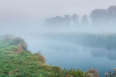 Morning mist over a small river Stock Photos