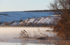 Morning mist over  spring river. Central Russia, the Don. Royalty Free Stock Image