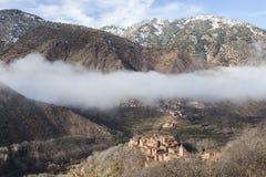 Berber village in Atlas. Morocco. Morning mist over a Berber village in the Atlas mountains, nearby the Toubkal massif. Morocco Stock Photo