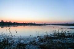 Morning mist over the water. In the Ukrainian steppe. Zaporozhye region, Ukraine. April 2004 Stock Image