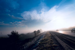 Morning mist on the road Royalty Free Stock Photo