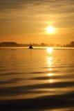 Morning Mist, Steveston Harbor Sunrise. A fish boat motors across Steveston Harbor on the Fraser River in British Columbia, Canada during a misty sunrise Royalty Free Stock Photo