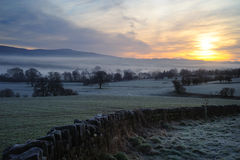 Morning Mist at Sunrise. Sun rising in the morning mist over The Eden Valley in Cumbria royalty free stock image