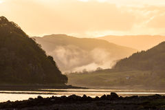 Morning mist at sunrise in the highlands Stock Photography