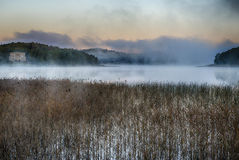 Morning mist at sunrise. Small lake with morning mist Royalty Free Stock Photos