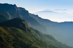 Morning Mist at Tropical Mountain Range Stock Images
