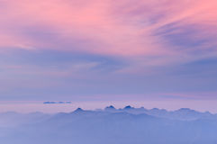 Morning Mist at Tropical Mountain Range at sunrise Stock Photos