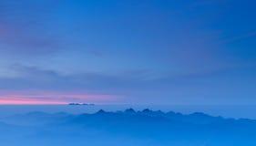 Morning Mist at Tropical Mountain Range at sunrise Royalty Free Stock Image
